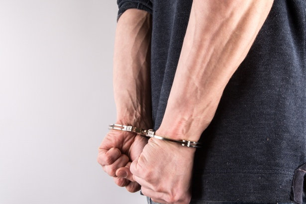 man with handcuffs on